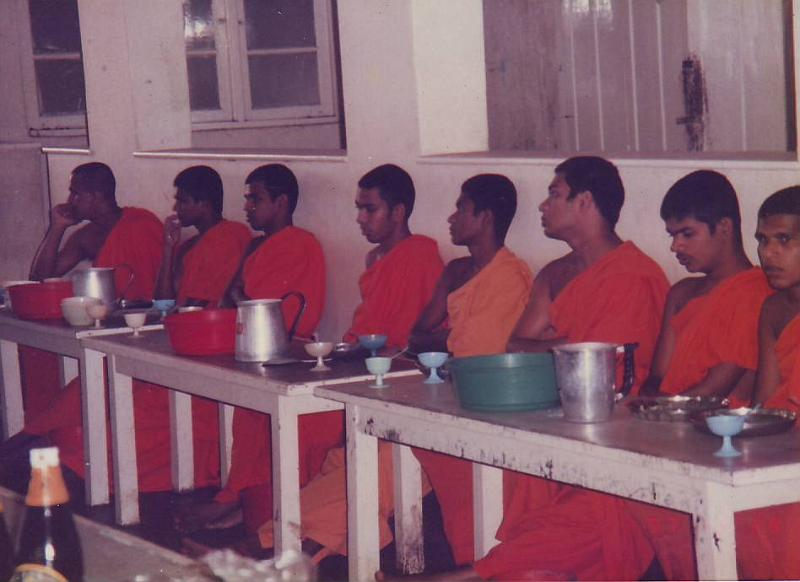 Buddhist Monks waiting for Lunch